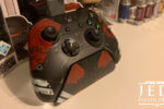 Xbox controller sitting on a charging stand