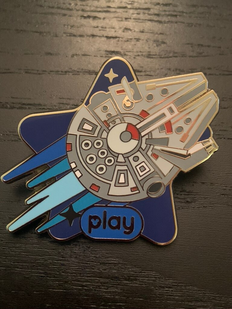 Millennium Falcon flying through space on a blue star shaped background