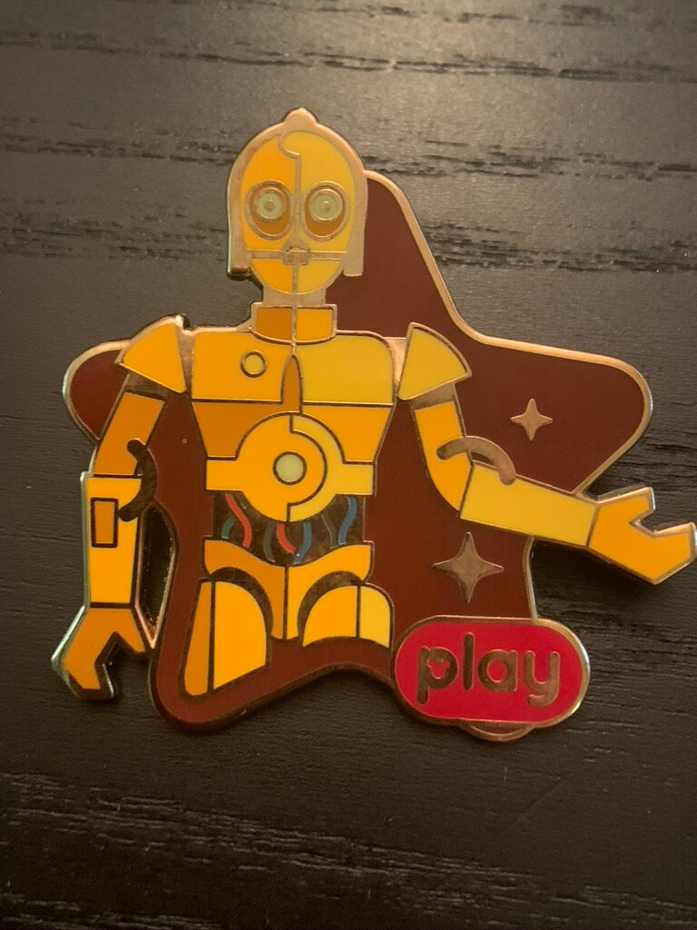 C-3PO standing on a brown star shaped background