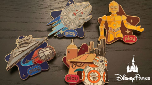 All 4 Disney Play Star Wars Pins on a table