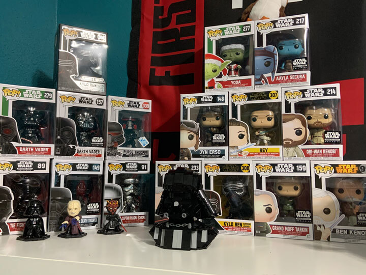 LEGO Darth Vader bust in front of Funko POP boxes for scale